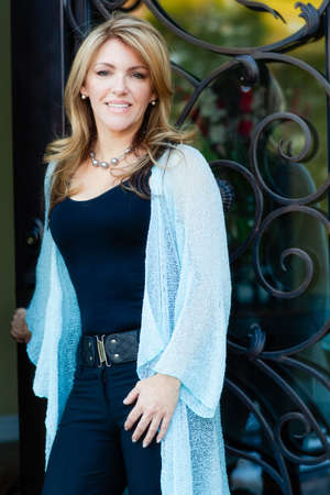 pleasant emotions: Beautiful Woman Realtor after closing the deal