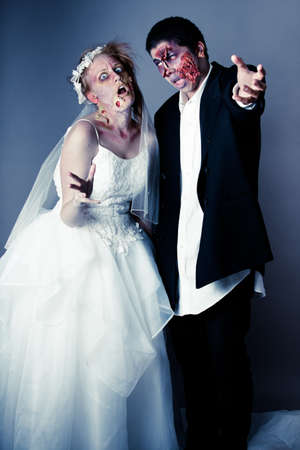 Zombie Bride and groom full Makeup in studio portrait photo