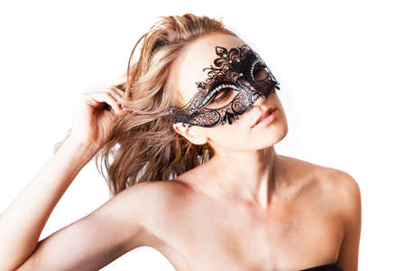 Beautiful Woman wearing a black dress and Venetian rhine stoned mask Isolated on white photo