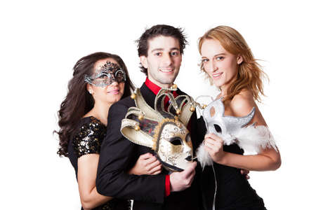 masquerading: Beautiful young people  with Venetian Masks and formal dress Masquerading Stock Photo
