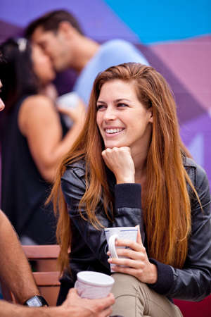 Focus on a Beautiful smiling woman with Long Hair engaged in a conversation photo