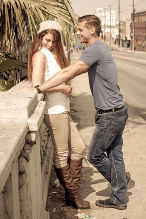 Young Couple Flirting in the city of Los Angeles, California photo