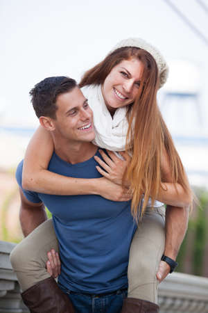 piggy back: Young Couple laughing in the city of Los Angeles, California