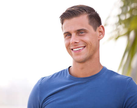and the horizontal man: Good looking athletic Guy Smiling outside