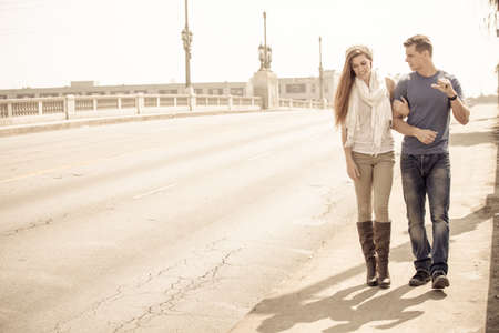 inlove: Young Couple walking and talking in the city of Los Angeles, California
