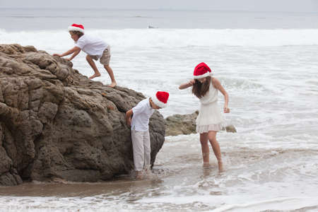 Children at the Beach in Xmas HatsMalibu,California photo