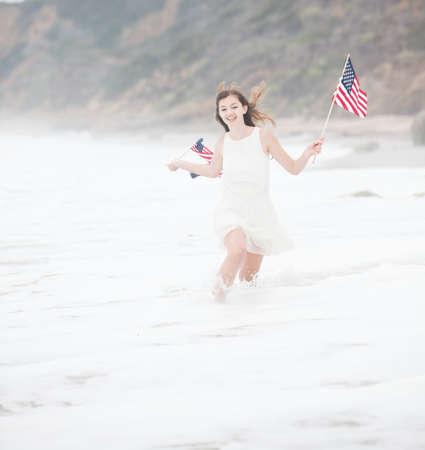 Beautiful Teen Girl with American flags walking on the Beach in Malibu Stock Photo - 22218307