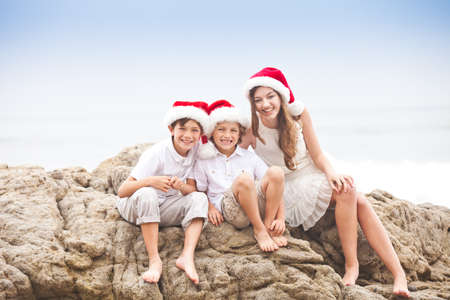 three people only: Christmas Family Portrait at the Beach in Malibu,California Stock Photo