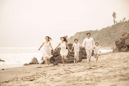 Happy Healthy Family Running at the beach in Malibu California Stock Photo - 22385672