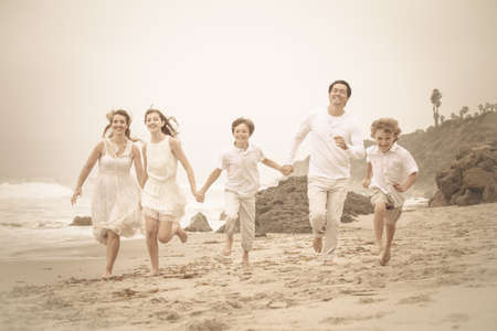 Happy Healthy Family Running at the beach in Malibu California photo