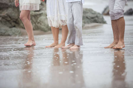 A family at the beach feet and Legs only Banco de Imagens