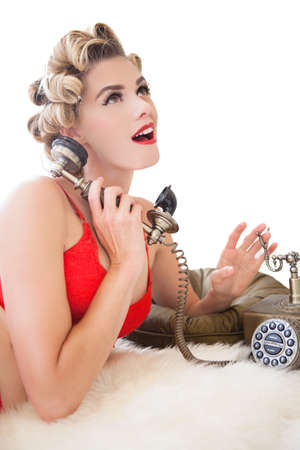 curls: Beautiful woman in curls on the telephone talking Stock Photo