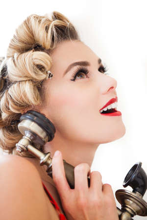 Beautiful woman in curls on the telephone talking photo