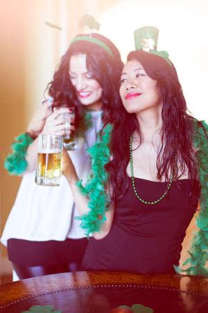 Happy women celebrating St Patrick's Day March 17th