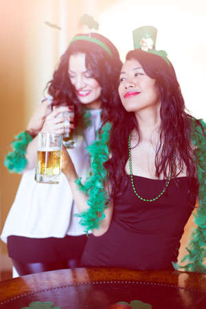 Happy women celebrating St Patricks Day March 17th