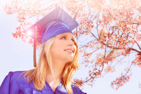 Graduation Pretty Blonde woman with sun flare photo