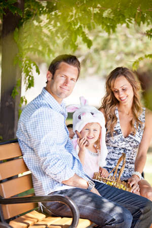 Beautiful young family together for Easter in the park Stock Photo