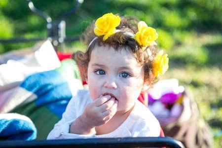 Cute toddler girl looking at camera 版權商用圖片