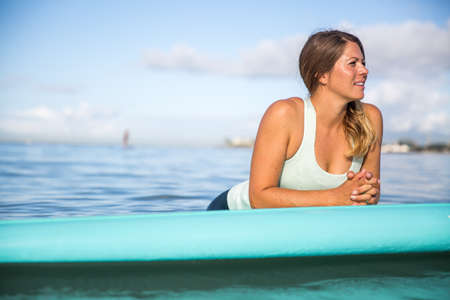 SUP Yoga Instructor on the water in Hawaii