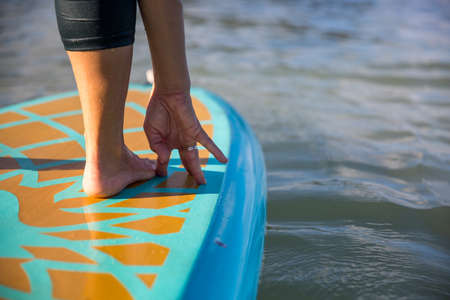 SUP yoga isolated select focus of foot and hand