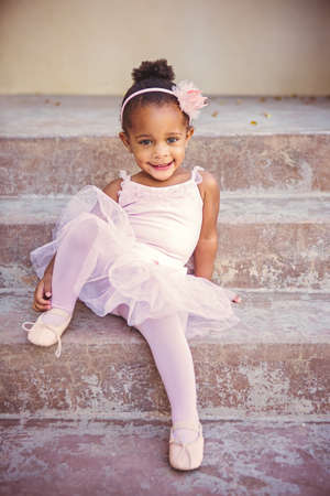 Happy toddler girl looking at camera in her ballet outfit 写真素材
