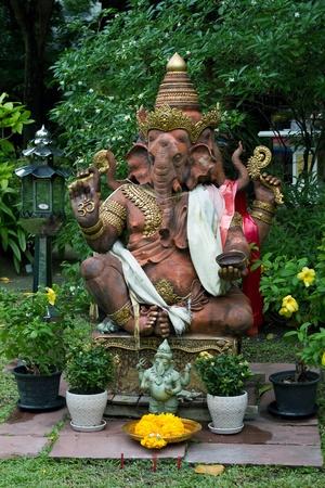 photo of lord Ganesha shrine in the garden photo
