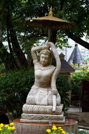 mother earth: Statue of Goddess of Land squeeze her hair