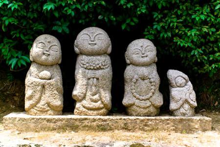 Four lplayful stone Buddhist statues in Arashiyama, Japan