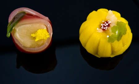 Two beautiful Japanese sweets (wagashi) shot side-by-side on black Stock Photo