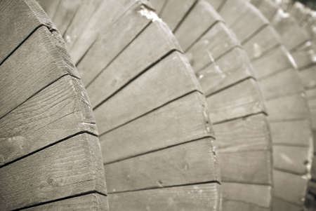 A close-up shot of a wooden archimedes screw previously used in a windmill