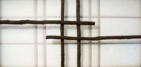A unique Japanese paper screen window with rough, overlapping branches