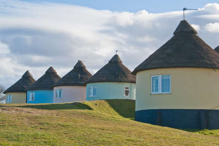 A group of African-inspired round holiday cottages near the English coast Stock Photo