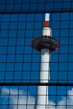 Kyoto tower reflecting in a skyscraper photo