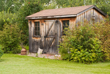 A charming, rustic garden shed made from reclaimed timber (barn board) 스톡 콘텐츠