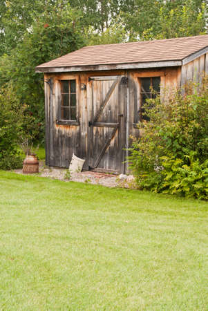 A Charming, Rustic Garden Shed Made From Reclaimed Timber (barn Board)  Stock Photo