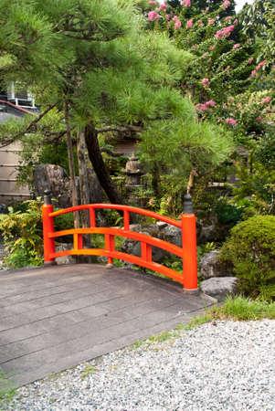 Japanese red stone bridge Stock Photo