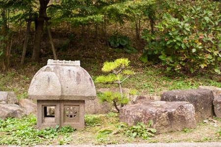 Japanese stone lantern and pine tree Stock Photo