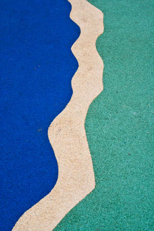 An abstract background of an outdoor play area floor Stock Photo
