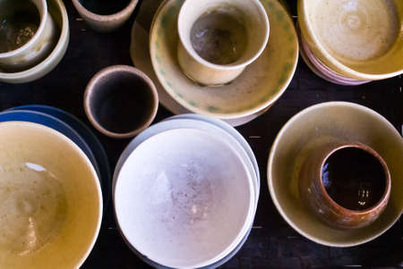 A collection of Japanese ceramic bowls and cups from above Stock Photo