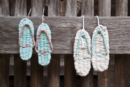 Two pairs of woven zori sandals hung outside a Japanese temple
