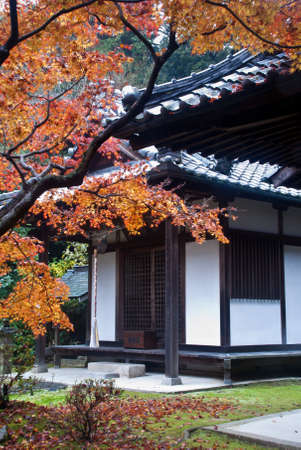 Colorful autumn foliage framing a Japanese temple building Stock Photo