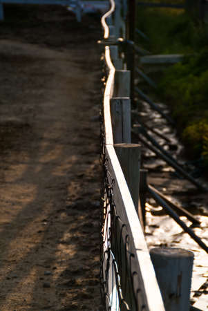 A highlighted railing fence cuts across the frame Stock Photo