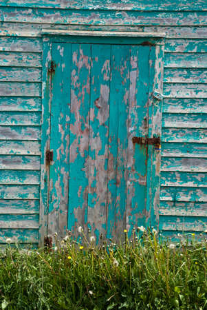 Closeup of an old blue-doored fishing shed