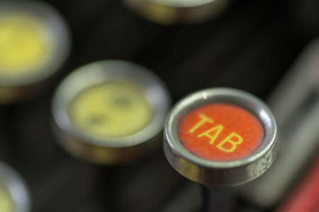 A closeup of the tab key of an antique typewriter. Stock Photo