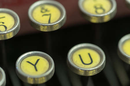 A closeup of the Y and U keys of an antique typewriter.