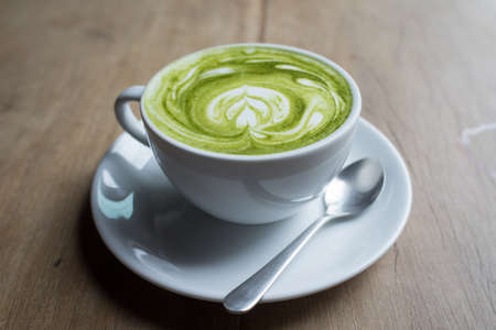 latte: Green tea cup with milk Stock Photo