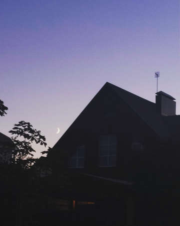 Private house against the background of the clear evening sky.