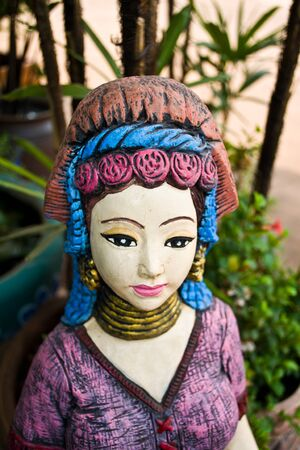 Statue of a woman. Used for landscaping beauty. Can be found online.