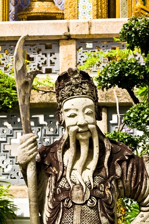 Chinese warrior statues of stone. Thai Palace pages. Editorial