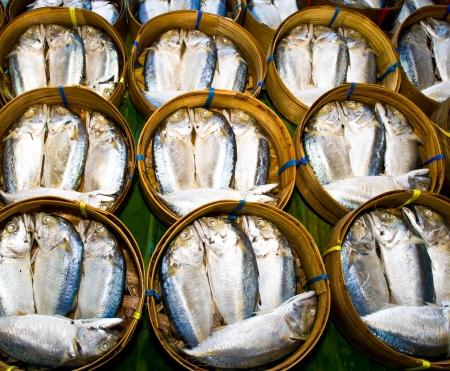 Mackerel fish in bamboo basket at market, Thailand